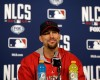 St. Louis Cardinals starting pitcher Adam Wainwright smiles during a news conference Friday, Oct. 10, 2014, in St. Louis. Wainwright will start for the Cardinals when they play the San Francisco Giants in Game 1 of baseball's National League Championship Series on Saturday in St. Louis.