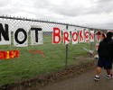 "Part of a sign that reads ""Cracked But Not Broken,"" is shown Monday, Oct. 27, 2014 at a growing memorial on a fence around Marysville Pilchuck High School in Marysville, Wash. On Friday, Oct. 24, student Jaylen R. Fryberg opened fire in the school cafeteria, killing two fellow students before taking his own life. A third student died Sunday night of her injuries. The school will be closed all week."