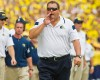 Michigan head coach Brady Hoke shouts trying to flag down a referee on the sideline in the third quarter of an NCAA college football game against Appalachian State in Ann Arbor, Mich., Saturday, Aug. 30, 2014. Michigan won 52-14.
