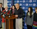 Kenneth Bae, center, who had been held in North Korea since 2012, talks to reporters after he arrived Saturday, Nov. 8, 2014, at Joint Base Lewis-McChord, Wash., after he was freed during a top-secret mission. Looking on from left are Bae's brother-in-law Andrew Chung, his mother, Myunghee Bae, his sister, Terri Chung, and nieces Ella and Caitlin Chung.
