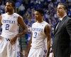 From left, Kentucky's Aaron Harrison, Tyler Ulis, and head coach John Calipari pause for a moment during the second half of an NCAA college basketball game, Saturday, Dec. 13, 2014. Kentucky won 84-70.