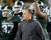 Michigan State head coach Mark Dantonio walks with his team before the first half of an NCAA college football game against Ohio State in East Lansing, Mich., Saturday, Nov. 8, 2014.