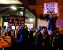 Protesters rallying against a grand jury's decision not to indict the police officer involved in the death of Eric Garner chant as they pass police while marching through Midtown in the early morning hours of Friday, Dec. 5, 2014, in New York.
