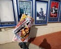 "A poster for the movie ""The Interview"" is carried away by a worker after being pulled from a display case at a Carmike Cinemas movie theater, Wednesday, Dec. 17, 2014, in Atlanta. Georgia-based Carmike Cinemas has decided to cancel its planned showings of ""The Interview"" in the wake of threats against theatergoers by the Sony hackers."