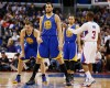Golden State Warriors' Andrew Bogut, left, returns a fist bump gesture from Los Angeles Clippers' Chris Paul, right, as Warriors' David Lee, rear left, and Stephen Curry, rear center, looks on before the start of their NBA basketball game in Los Angeles, Wednesday, March 12, 2014.