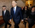 Washington Gov. Jay Inslee, second from left, walks back to his office after giveing his annual State of the State speech, Tuesday, Jan. 13, 2015, to a joint session of the Washington Legislature in Olympia, Wash.