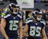 Seattle Seahawks wide receiver Jermaine Kearse (15) celebrates after scoring on a 63-yard touchdown reception next to wide receiver Doug Baldwin (89) during the first half of an NFL divisional playoff football game against the Carolina Panthers in Seattle, Saturday, Jan. 10, 2015.