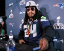 Seattle Seahawks' Marshawn Lynch sets his timer for five minutes at a news conference for NFL Super Bowl XLIX football game, Wednesday, Jan. 28, 2015, in Phoenix. The Seahawks play the New England Patriots in Super Bowl XLIX on Sunday, Feb. 1, 2015.