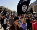 FILE - In this June 16, 2014 file photo, demonstrators chant pro-Islamic State group, slogans as they carry the group's flags in front of the provincial government headquarters in Mosul, 225 miles (360 kilometers) northwest of Baghdad. ISIS placed eighth on Google's list of 2014's fastest-rising global search requests, the company said Tuesday, Dec. 16, 2014.