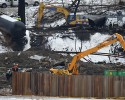 Clean up continues near Mount Carbon, West Virginia, Monday, Feb. 23, 2015, where a train that derailed and sent a tanker with crude oil into the Kanawha River. A full-scale federal investigation of an oil train derailment in southern West Virginia has begun as work continues to remove the overturned tank cars from the site, federal officials said Sunday. A fire sparked by the Feb. 16 derailment in Mount Carbon prevented investigators from gaining full access to the crash scene until this weekend.