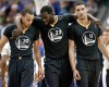 Golden State Warriors guard Stephen Curry (30), Draymond Green (23) and Klay Thompson (11) walk up court during the second half of an NBA basketball game against the Dallas Mavericks, Saturday, Dec. 13, 2014, in Dallas. Curry had 29-points, Green had 20-points and Thompson had 25-points in the 105-98 Warriors win.