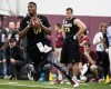 Jameis Winston rolls out to pass during Florida State football pro day in Tallahassee, Fla., Tuesday, March 31, 2015.