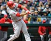 Los Angeles Angels' Mike Trout homers against the Seattle Mariners in the first inning of a baseball game, Monday, April 6, 2015, in Seattle.
