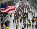 Runners approach the finish line in the rain during the Boston Marathon, Monday, April 20, 2015, in Boston.