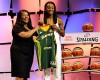 Notre Dame's Jewell Loyd, right, holds up a Seattle Storm jersey with WNBA president Laurel J. Richie after the Storm selected Loyd as the No. 1 pick in the WNBA basketball draft, Thursday, April 16, 2015, in Uncasville, Conn.