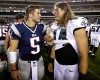 New England Patriots' Tim Tebow, left, and Philadelphia Eagles' Riley Cooper meet after a preseason NFL football game, Friday, Aug. 9, 2013, in Philadelphia. New England won 31-22.