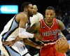 Portland Trail Blazers guard Damian Lillard (0) plays against Memphis Grizzlies guard Mike Conley, left, in the first half of an NBA basketball game Saturday, March 21, 2015, in Memphis, Tenn.