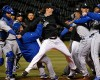 Chicago White Sox's Jeff Samardzija, center, fights with Kansas City Royals players during the seventh inning of a baseball game Thursday, April 23, 2015, in Chicago.
