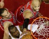 Chicago Bulls forward Taj Gibson, top, and center Joakim Noah, left, fight for a rebound against Cleveland Cavaliers forward LeBron James during the first half of Game 1 in a second-round NBA basketball playoff series Monday, May 4, 2015, in Cleveland.