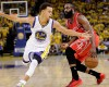 Houston Rockets guard James Harden, right, dribbles against Golden State Warriors guard Stephen Curry (30) during the first half of Game 2 of the NBA basketball Western Conference finals in Oakland, Calif., Thursday, May 21, 2015.