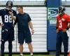 Seattle Seahawks quarterback Russell Wilson, right, listens as tight ends coach Pat McPherson, center, talks with tight end Jimmy Graham (88) during an NFL football organized team activity, Tuesday, June 2, 2015, in Renton, Wash.