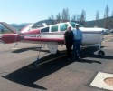 Leland and Sharon Bowman of Marion, MT, stand next to their small plane in this undated photo.