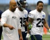 Seattle Seahawks safety Earl Thomas, right, walks off the field with defensive coordinator Kris Richard, second from left, after an organized team activity Tuesday, June 2, 2015, in Renton, Wash.