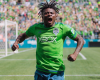 Seattle's Obafemi Martins celebrating his goal against the Portland Timbers