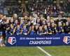 FC Kansas City pose with the trophy after the NWSL soccer championship match in Portland, Ore., Thursday, Oct. 1, 2015. FC Kansas City won the match 1-0. (AP Photo/Craig Mitchelldyer)