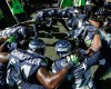 """Seattle Seahawks' strong safety Kam Chancellor, lower left, huddles with his defensive teammates in the """"Legion of Boom"""" before taking the field for warmups before an NFL football game against the Chicago Bears, Sunday, Sept. 27, 2015, in Seattle. It was Chancellor's first time back on the field following a contract holdout the first part of the season. (AP Photo/Elaine Thompson)"""