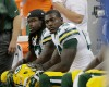 Green Bay Packers running back Eddie Lacy, background, and running back James Starks are seen on the bench during the second half of an NFL football game against the Detroit Lions in Detroit, Sunday, Sept. 21, 2014. (AP Photo/Duane Burleson)