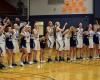 The Lynden Christian girls basketball team celebrating their win over Nooksack Valley