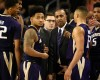 FILE - In this Saturday, Jan. 30, 2016, file photo, Washington head coach Lorenzo Romar, center, talks with his team during a break in play in the first half of an NCAA college basketball game against Southern California in Los Angeles. Whistles have become the soundtrack for Washington basketball. The Huskies lead the country in number of players to foul out and are well on their way to seeing the most players foul out of any team in the past 20 seasons. (AP Photo/Kelvin Kuo, File)