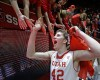 Utah forward Jakob Poeltl (42) celebrates with fans following an NCAA college basketball game against Colorado, Wednesday, Jan. 7, 2015, in Salt Lake City. Utah won 74-49. (AP Photo/Rick Bowmer)