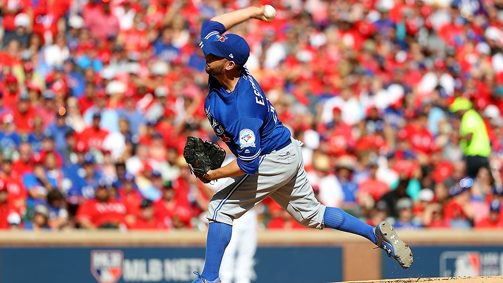 Jays hammer Hamels, Rangers to take Game 1