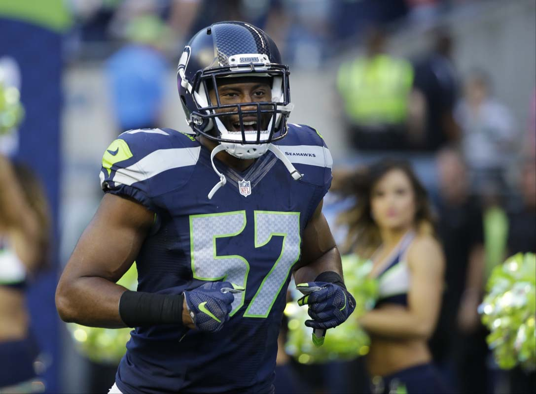 Seattle seahawks outside linebacker mike morgan runs from the tunnel