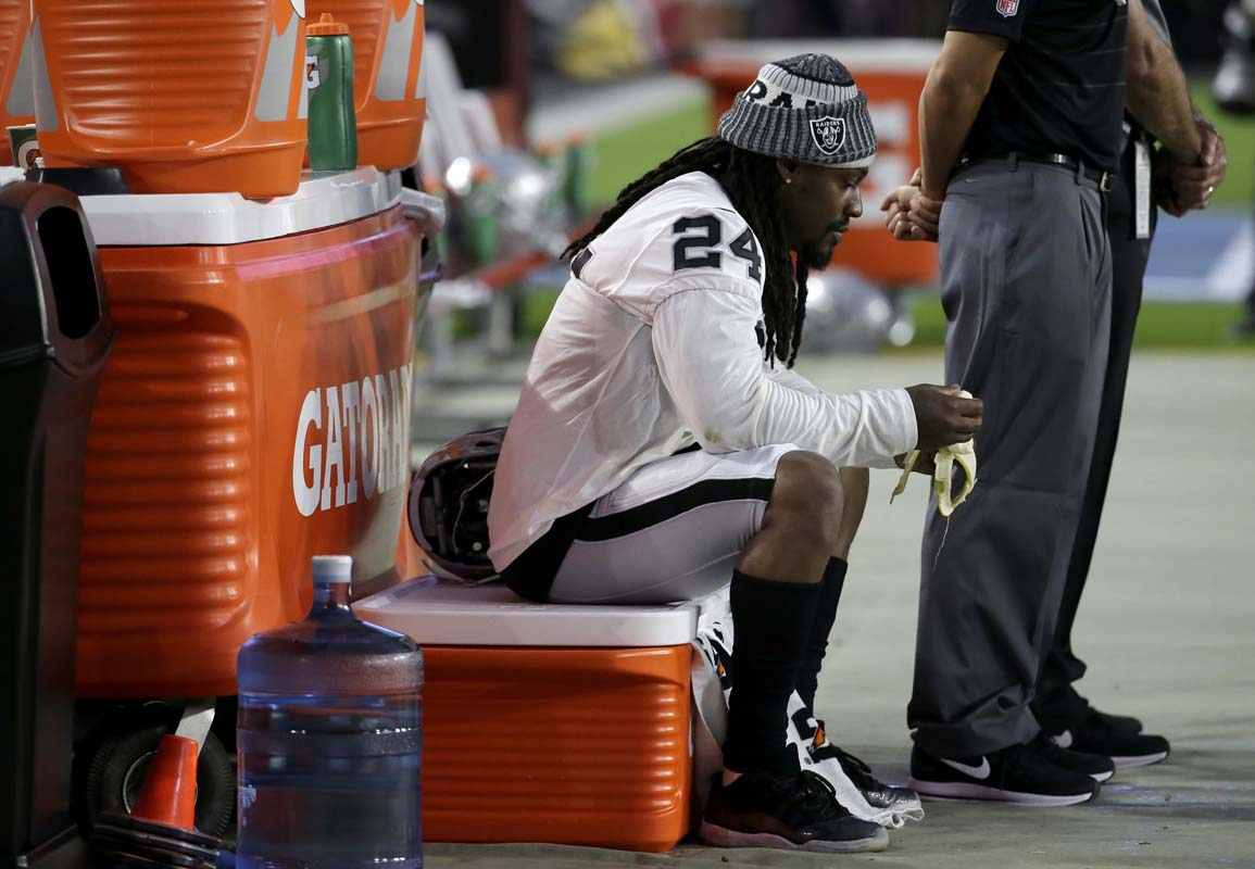 Raiders Marshawn Lynch sits during national anthem at preseason NFL game